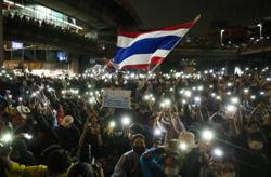 Thai Parliament to decide on special meeting as protesters rally