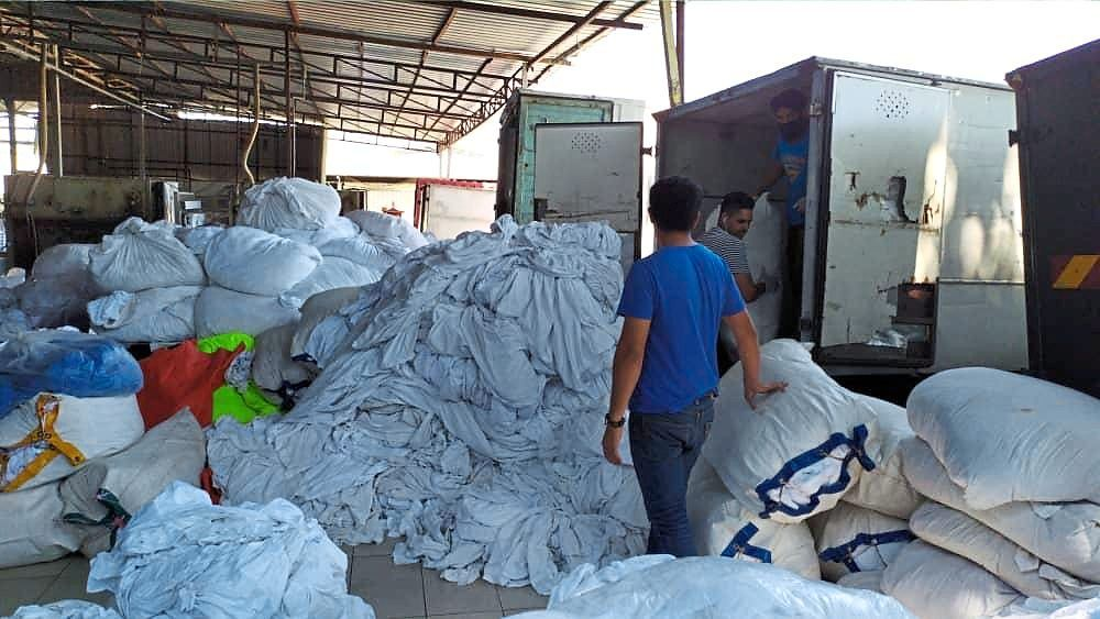 Bags of dirty laundry from hotels piled up in one of the laundry factories during the water cut last month.