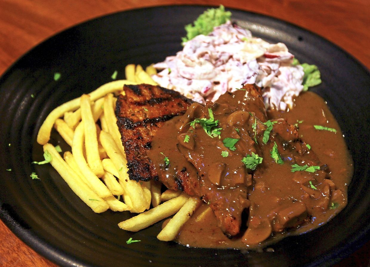 Crispy Pork Chops with mushroom sauce. The apple and red cabbage salad adds a tasty crunch.
