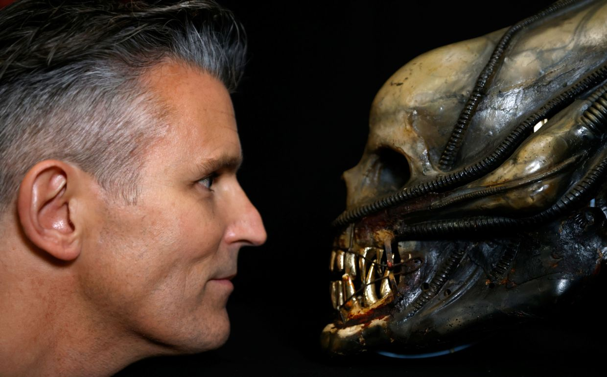 Stephen Lane, CEO of Prop Store, poses with a special effects mechanical head from the film 'Alien'. Photo: Reuters