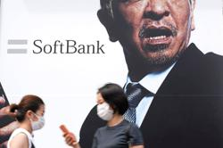 SoftBank hits 20-year high
