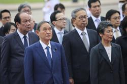 Japan's PM Suga arrives in Indonesia to affirm deeper ties