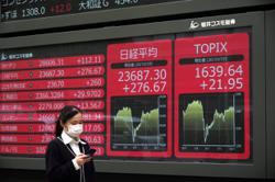 Asian shares mixed as US virus aid hopes fade