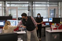 Offices resort to sensors in futile attempts to keep workers apart
