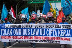 Thousands of Indonesians take to the streets to protest new labour law