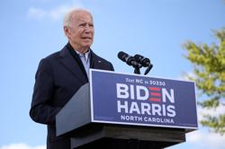 Biden leads Trump in Michigan, race statistically even in North Carolina - Reuters/Ipsos poll