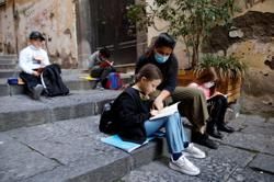 Naples teachers bring socially distanced school to streets and balconies