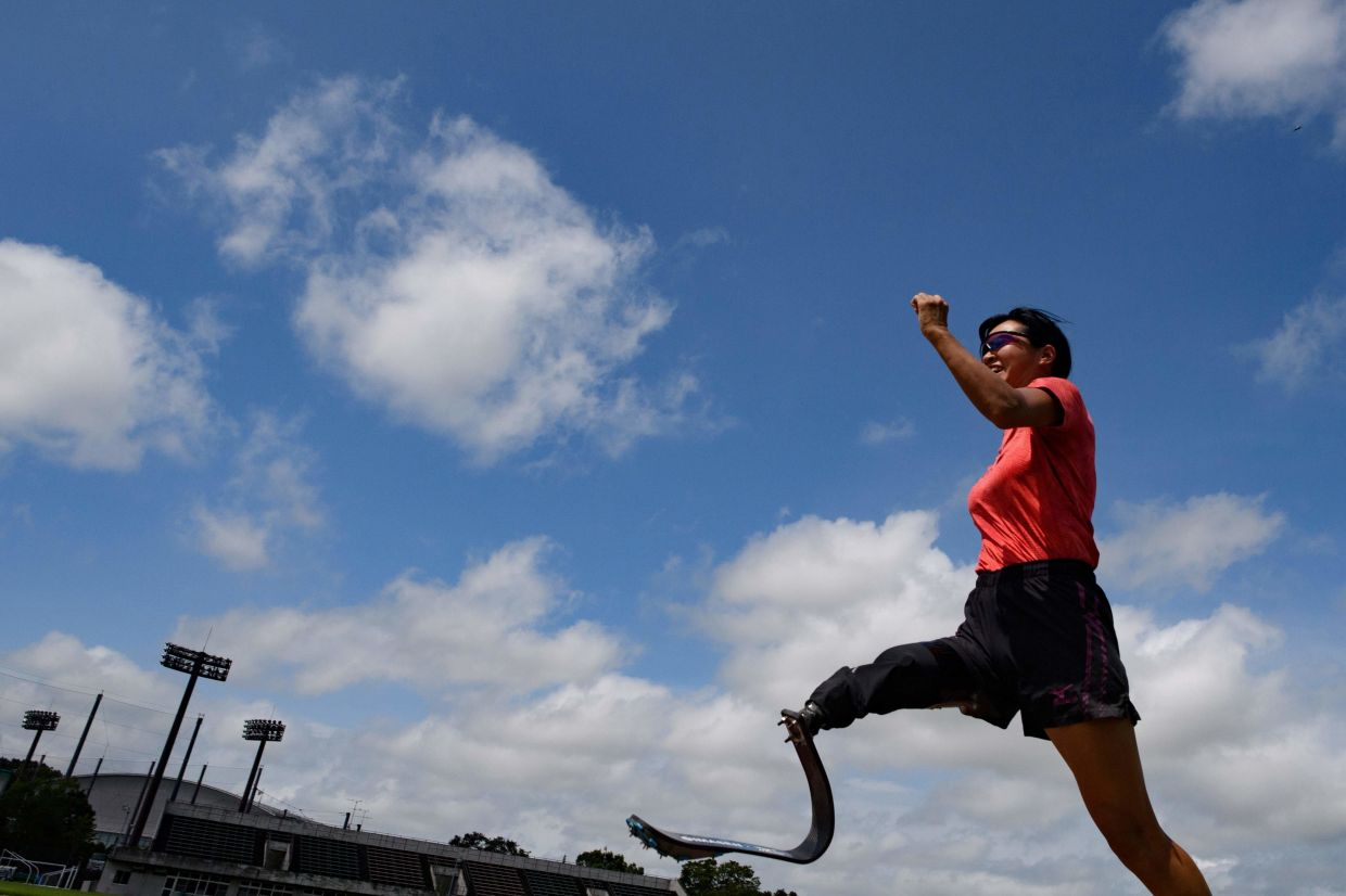 Murakami lost her right leg in a train accident when she was 25 and competes with a prosthetic blade.