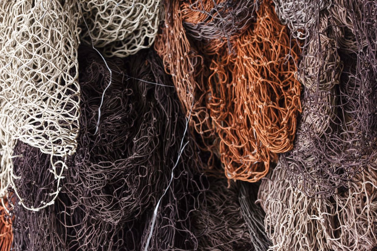 Jaguar Land Rover says regenerated nylon from fishing nets will go into making floor mats and trims in future cars. — Pietro Firrincieli/Jaguar Land Rover/dpa