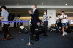 Japan to ease entry rules for business trips of up to three days - report