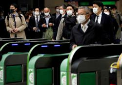 Japan researchers show masks do block coronavirus, but not perfectly