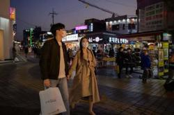 Covid-19 cases in S. Korea jump a week after lifting restrictions