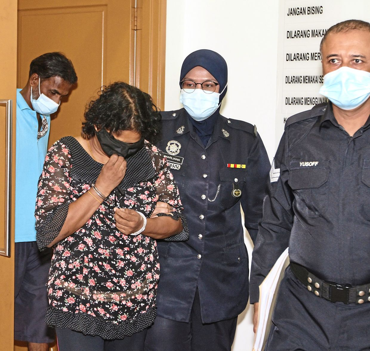 Day in court: (From left) Vijaya and Angela Dewi exiting the courtroom.  — LOW BOON TAT/ The Star.