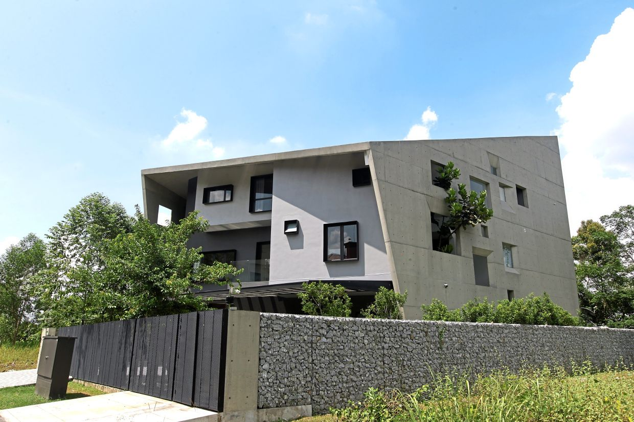 The window house has a concrete shell that wraps the house from east to west.  Photo: The Star / Azman Ghani