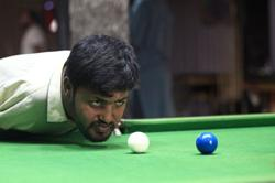 Born without arms, plenty of moxie, Pakistani man masters snooker