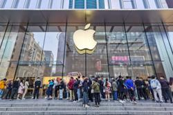 Short queues in China as Apple's newest iPhone 12 hits stores