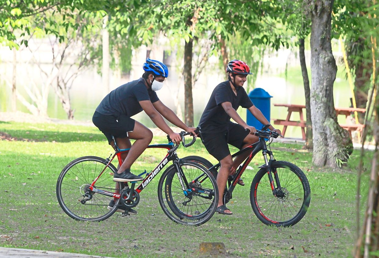 Health-conscious Petaling Jaya residents keep to their exercise routine at parks in the city while being mindful of the conditional MCO guidelines.