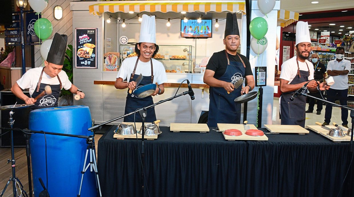 The BatteryHeadz drumming up some rhythms with kitchen utensils at the grand launch of Gurney Food Hall in Gurney Plaza, Penang.