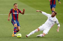 Real Madrid sink Barca in 'Clasico' with help of Ramos penalty