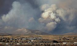 'Fingers crossed and prayers': Colorado wildfire kills couple, forces more evacuations