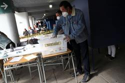 Record turnout seen as Chileans vote in constitutional referendum