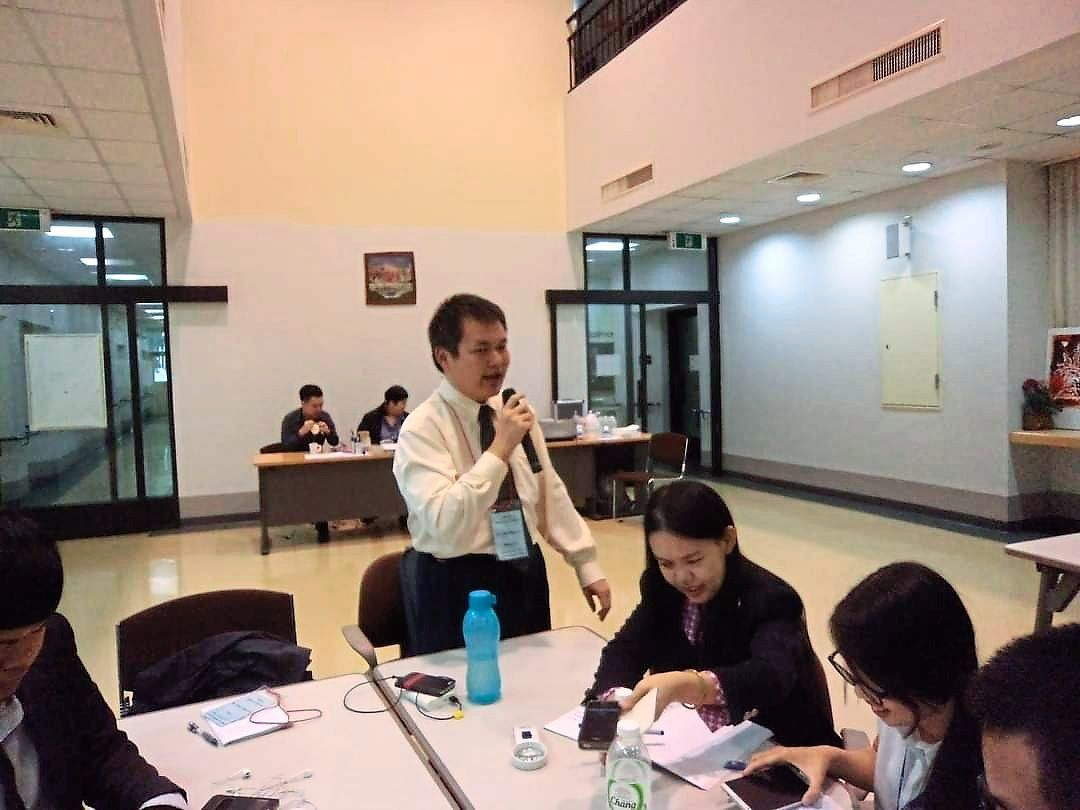 Lim (holding microphone), who tutored UM students for two years, is now working as an administrative executive which he is overqualified for.