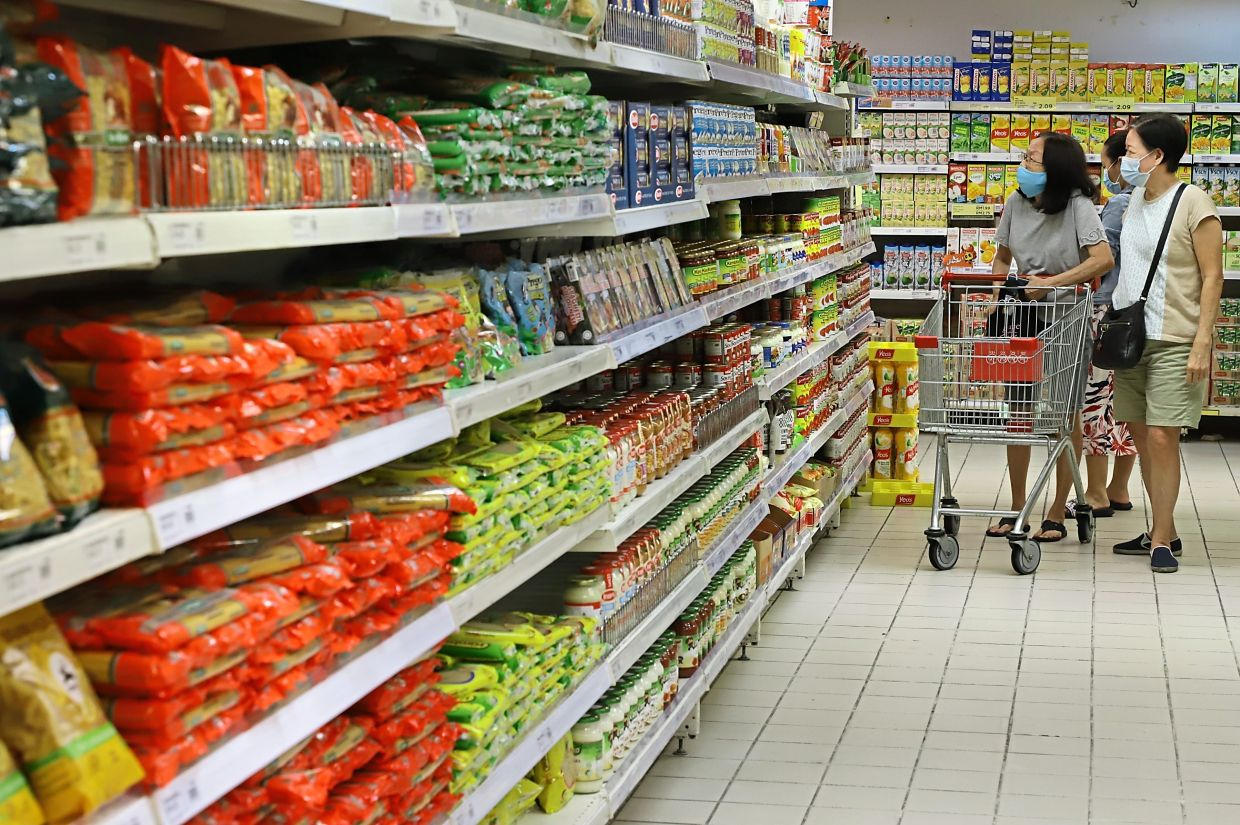 Shelves are full as shoppers take their time choosing items at the grocery section at Sunshine Square in Bayan Baru.
