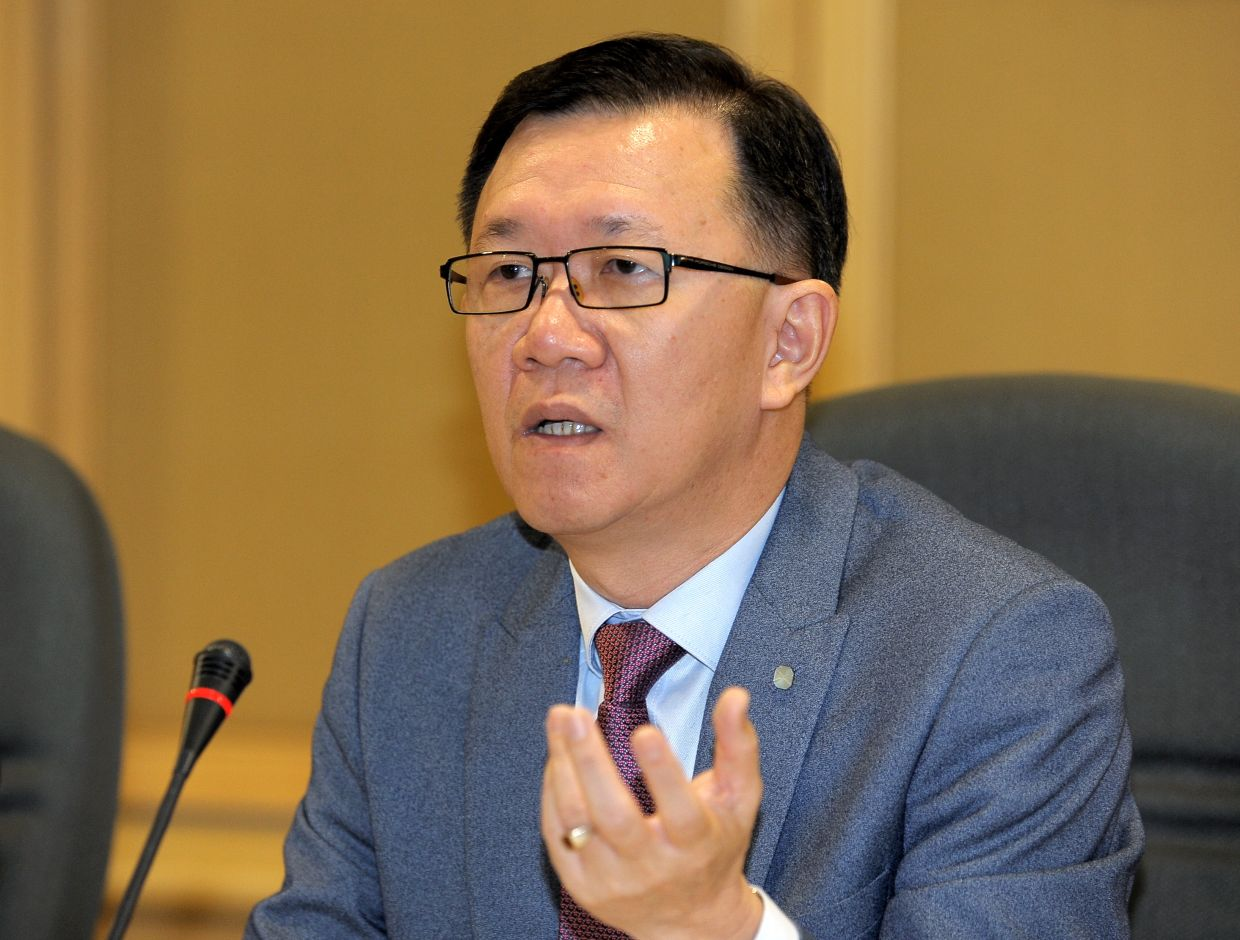 """SERC executive director Lee Heng Guie: \""""The state of worry, anxiety and stress about the rising numbers of new infection cases would dent a full restoration of consumers' sentiment and still sluggish business confidence.\"""""""