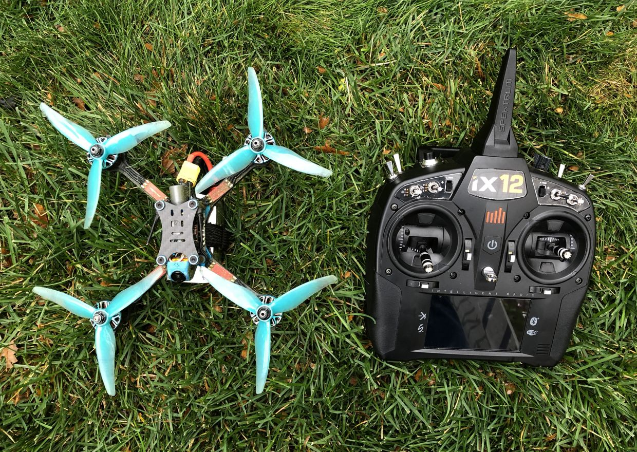 The racing drone and remote controller that belongs to Jake, 14, of Plymouth, Michigan. He was showing off flying his racing drone in his backyard. — Detroit Free Press/TNS