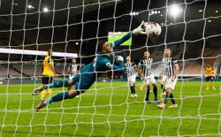 Late Murphy goal gives Newcastle share of points at Wolves