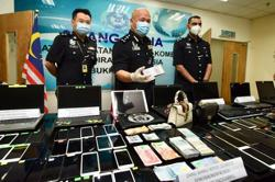 Investment scams: Cops arrest 12 China nationals in KL call centre raid