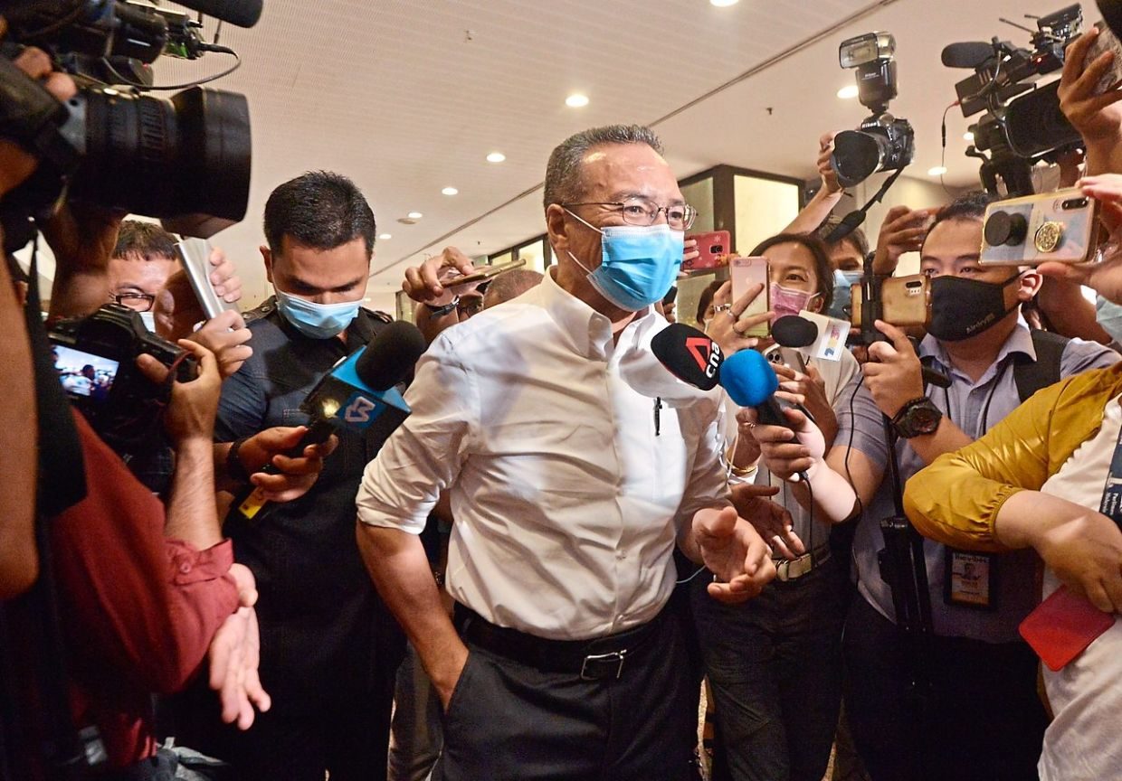 Political gathering: Hishammuddin arriving for the Barisan lawmakers' meeting at PWTC in Kuala Lumpur, which Zahidi (below, in this file photo) also attended. — Raja Faisal Hishan/The Star
