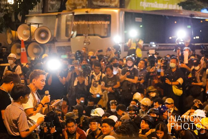 Pro-democracy demonstrators read their statement outside the German embassy on Monday night (Oct 26, 2020). - The Nation Thailand/Asian News Network