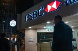 HSBC to revamp business model as lower interest rates hit profit