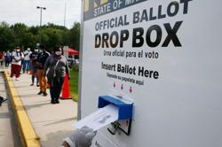 Pandemic transforms some Americans into voting rights activists in raft of lawsuits