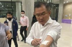 Thai MP slashes own arm in Parliament to protest treatment of protesters