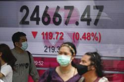 Asian markets extend losses as virus surges in US, Europe