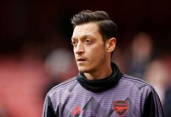 Arsenal's Ozil backs free school meals campaign
