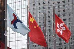 HK shares track global equities lower on Covid-19 resurgence