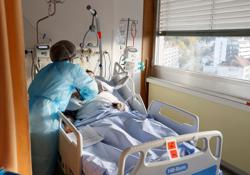 'Overwhelming' COVID second wave floods Swiss hospitals