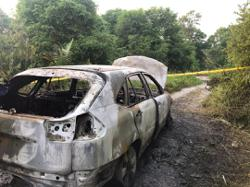 Charred body found in car near Sepang