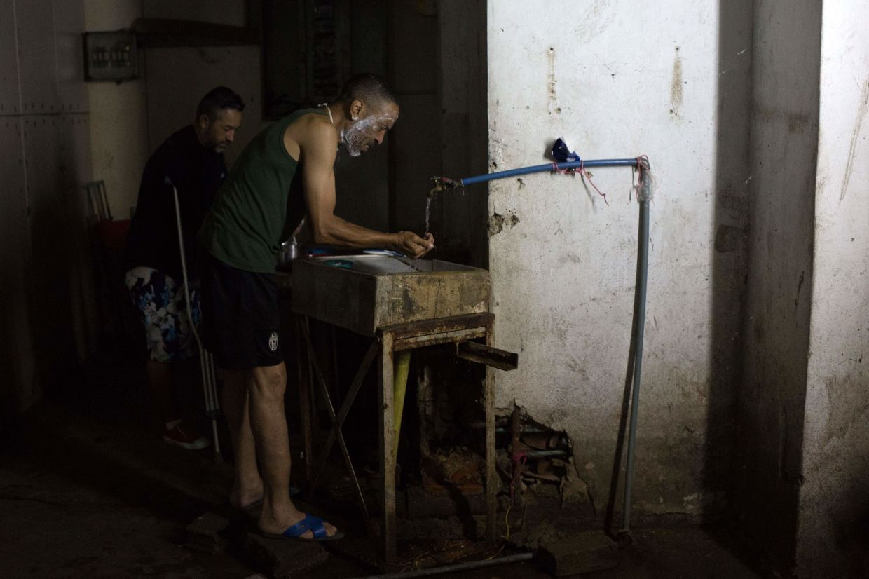 Fourteen families live without electricity, ventilation, running water or bathrooms in the basement of a government building in Caracas, which makes them specially vulnerable to the coronavirus.