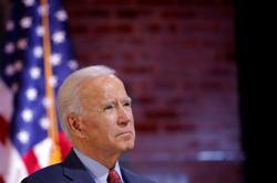 Biden urges end to looting after Philadelphia Black man's killing