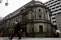 BOJ trims growth forecast but keeps upbeat view on outlook, signals policy pause