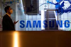 Samsung reports record sales amid questions about future