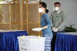Myanmar president and Suu Kyi cast advance votes for general elections