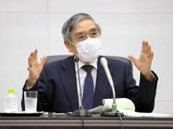 Bank of Japan cuts growth outlook, holds monetary policy