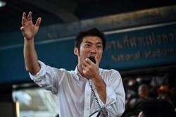 Thai opposition figure Thanathorn charged over illegal protest