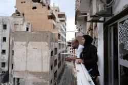 Scarred by war but home at last, two Libyan families pray for peace