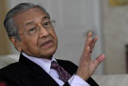 Twitter deletes Dr M's post after flagging it as 'glorifying violence'